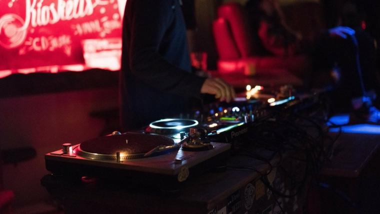 DJ mixing on the decks